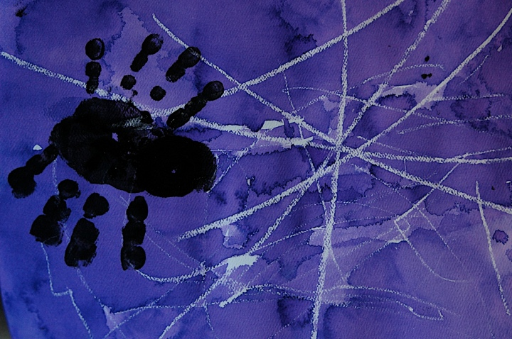 Toddler Art: Using watercolor over crayon resist for halloween Spider Handprint